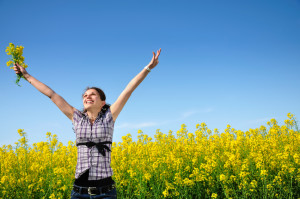 Girl in a yellow field, freedom