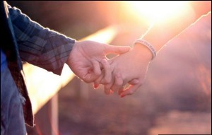 holding-hand-love-sunset